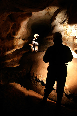 Spelunkers discovering a new underground cave passage