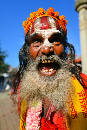 KATHMANDU, NEPAL - OCTOBER 8  Holy Sadhu man with long beard and traditional painted face at the Durbar square  On October 8, 2013 in Kathmandu, Nepal