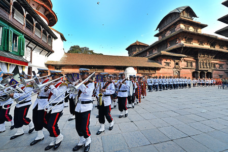 KATHMANDU - OCT 11  Musicians of the Nepali Military Orchestra marching in the inner courtyard of the Royal Palace, during the Dasain festival  On October 11, 2013 in Kathmandu, Nepal