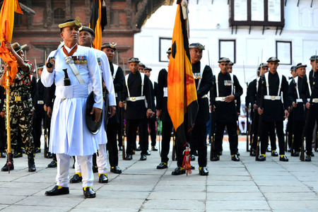 KATHMANDU, NEPAL - OCT 11  Nepalese Royal guards standing in the inner courtyard of the Royal Palace on October 11, 2013 in Kathmandu, Nepal  The Royal soldiers are the Nepalese King favorite army