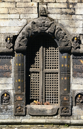 Carved and sculpted entrance in a Hindu temple  Pashupatinath, Nepal photo