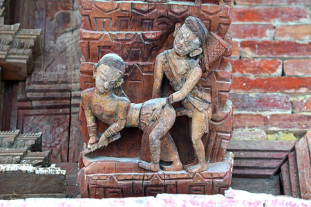 Erotic carving, explicit Kama Sutra position on a Nepali temple in Patan, Kathmandu, Nepal