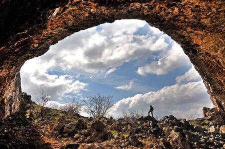 rock arch: A rock arch and a cave entrance