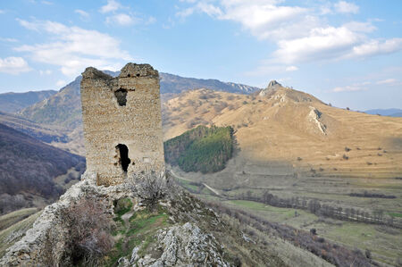 Ruins of a fortress on a rock  Transylvania, Romania photo