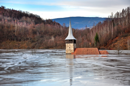 Flooded church by contaminated water and mud  Geamana, Romania photo
