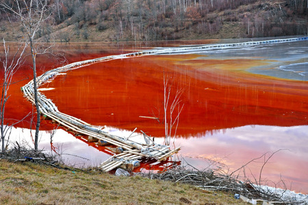 Contaminated red water polluted from a copper mine  Geamana, Romania photo