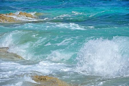 Sea waves crushing on a rocky beach in Croatia  photo