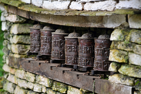 Prayer wheels in a Buddhist temple photo