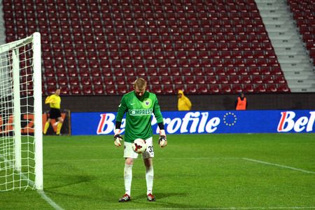 cfr cluj: CLUJ NAPOCA, ROMANIA - MARCH 4  Goalkeeper of Universitatea Cluj, Robert Veselovsky playing with a ball during a derby against CFR Cluj  Final score  CFR Cluj - U Cluj  1-2  On March 24, 2014 in Cluj-Napoca, Romania