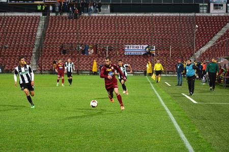 cfr cluj: CLUJ NAPOCA, ROMANIA - MARCH 4  Midfielder of CFR Cluj, Vasile Maftei dribling during a match against Universitatea  Final score  CFR Cluj - U Cluj  1-2  On March 24, 2014 in Cluj-Napoca, Romania