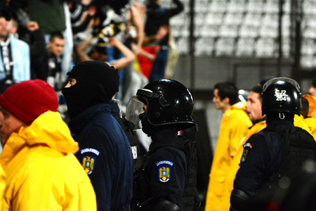 cfr cluj: CLUJ - MARCH 4: Police and stewards trying to stop the hooligans of the U Cluj soccer team to run on the field during a match against CFR Cluj. Final score: CFR Cluj - U Cluj: 1:2. On March 4, 2014 in Cluj, Romania