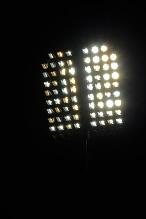 Bright stadium lights and dark blue sky  photo