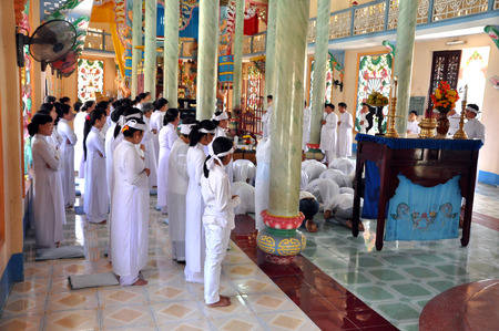 adherents: MY THO, VIETNAM - FEBRUARY 16  Religious ceremony in a Cao Dai Temple  The estimated number of Cao Dai new religion adherents in Vietnam are to 2 to 3 million  On 16 February, 2013 in My Tho, Vietnam