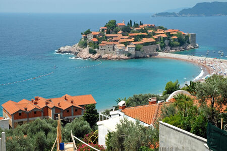 Small Mediterranean village near the cost of Adriatic sea  Sveti Stefan, Montenegro photo