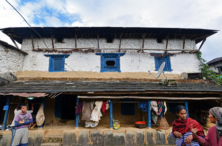 accomodation: GHANDRUK, NEPAL - OCTOBER 6  Traditional Gurung lodge in the village, used every year by hundreds of tourists and climbers for accomodation, in the way to Annapurna Base Camp  On Oct  6, 2013 in Ghandruk, Nepal Editorial