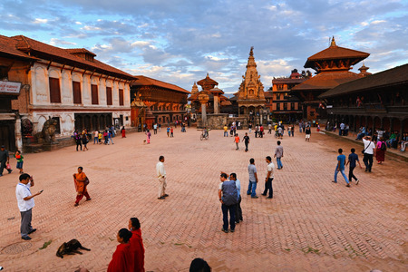 KATHMANDU, NEPAL - OCT 10  Tourists visiting the famous Durbar square of Bhaktapur at sunset, part of Unesco heritage on October 10, 2013 in Kathmandu, Nepal