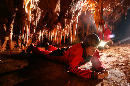 A Paleontologist studying fossils in a cave