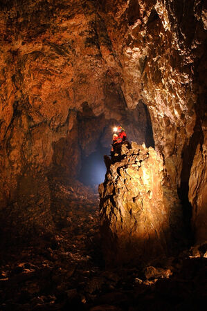 palaeolithic: Giant cave hall with a spelunker