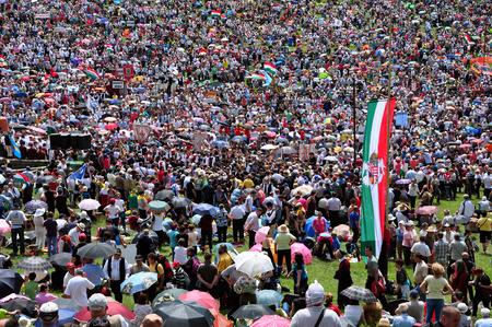 CSIKSOMLYO, ROMANIA - JUNE 7  Crowds of Hungarian pilgrims gather to celebrate the Pentecost and the catholic pilgrimage on June 7, 2014 in Sumuleu Ciuc  Csiksomlyo , Romania