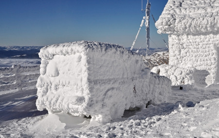 wintry weather: Snow covered truck at winter