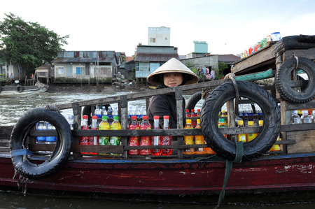 CAN THO - FEB 17: Unidentified merchants at the Floating Market. With hundreds of boats, Cai Rang is the biggest floating market in the Mekong Delta. On Feb. 17, 2013, in Can Tho, Vietnam
