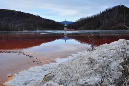 Industrial mining waste water. Rosia Montana, Romania photo