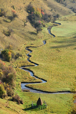 meandering: Autumn mountain landscape with a small meandering water stream