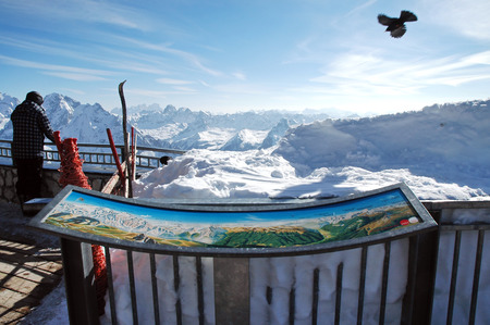 MARMOLADA, ITALY -  NOVEMBER 1: Skiers enjoy the first ski day of the year in Marmolada ski panoramic view point, in the Italian Dolomities. On November 1, 2010 in Marmolada, Italy