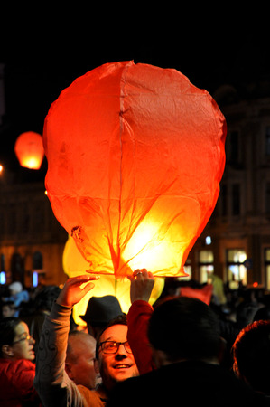 CLUJ NAPOCA, ROMANIA - NOVEMBER 8: Romanians celebrate King Michaels name day, with thousands of air balloons released at night, as a sign of respect for his Majesty. On Nov. 8, 2014 in Cluj, Romania Editorial