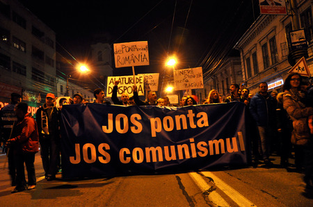 CLUJ, ROMANIA - NOVEMBER 8: Before the second round of Presidential Elections citizens protest against the socialist candidate, Victor Ponta. On Nov 8, 2014 in Cluj, Romania