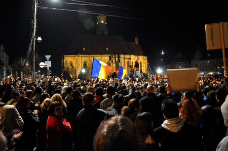 klaus: CLUJ, ROMANIA - NOVEMBER 16: Citizens of Cluj city celebrating the victory of Klaus Johannis against Victor Ponta after the second round of Presidential Elections. On Nov 16, 2014 in Cluj, Romania