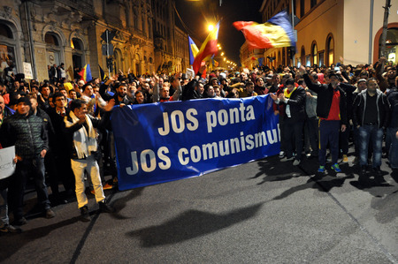 election night: CLUJ, ROMANIA - NOVEMBER 16: Citizens of Cluj city celebrating the victory of Klaus Johannis against Victor Ponta after the second round of Presidential Elections. On Nov 16, 2014 in Cluj, Romania