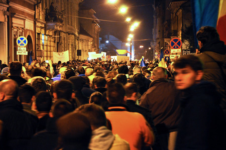 CLUJ, ROMANIA - NOVEMBER 16: Citizens of Cluj city celebrating the victory of Klaus Johannis against Victor Ponta after the second round of Presidential Elections. On Nov 16, 2014 in Cluj, Romania