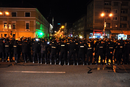 election night: CLUJ, ROMANIA - NOVEMBER 16: Riot police in alert against anti-government protesters during the Romanian Presidential Elections. On Nov 16, 2014 in Cluj, Romania Editorial