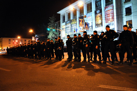 presidency: CLUJ, ROMANIA - NOVEMBER 16: Riot police in alert against anti-government protesters during the Romanian Presidential Elections. On Nov 16, 2014 in Cluj, Romania Editorial