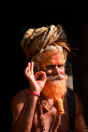 alleged: KATHMANDU - OCT 8: Sadhu at Pashupatinath in Kathmandu. Sadhus are holy men who have chosen to live an ascetic life and focus on the spiritual practice of Hinduism. On Oct 8, 2013 in Kathmandu, Nepal Editorial