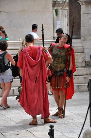 role play: SPLIT, CROATIA - AUGUST 26: Men dressed as Roman soldiers for tourists in the Old Town of Split, Croatia. Split