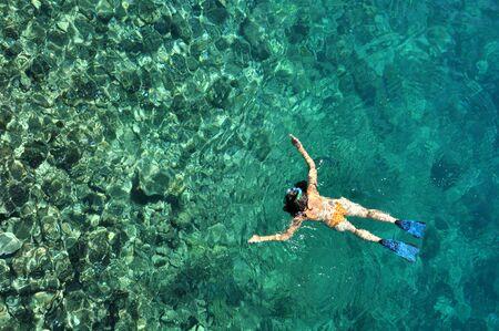 Woman snorkeling at Phi Phi Island, Phuket, Thailand photo