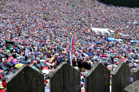 gather: CSIKSOMLYO, ROMANIA - JUNE 7: Crowds of Hungarian pilgrims gather to celebrate the Pentecost and the catholic pilgrimage on June 7, 2014 in Sumuleu Ciuc (Csiksomlyo), Romania