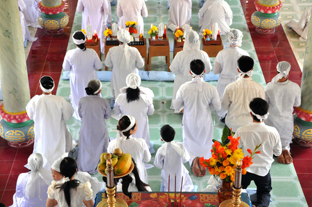 adherents: MY THO, VIETNAM - FEBRUARY 16: Religious ceremony in a Cao Dai Temple. The estimated number of Cao Dai new religion adherents in Vietnam are to 2 to 3 million. On 16 February, 2013 in My Tho, Vietnam