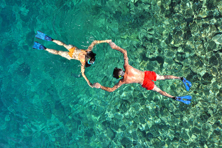 Romantic couple snorkeling in Phuket, Thailand 스톡 콘텐츠