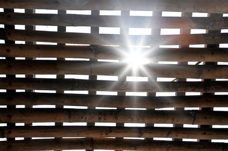 penal institution: Sunrays coming through barred bamboo cage, jail in Vietnam