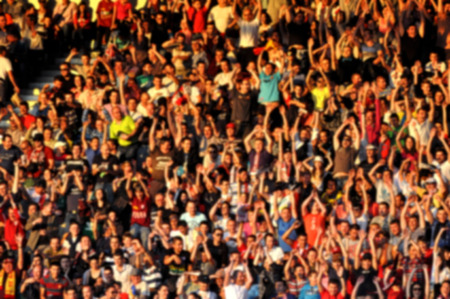 thousands: Blurred crowd of people in a stadium
