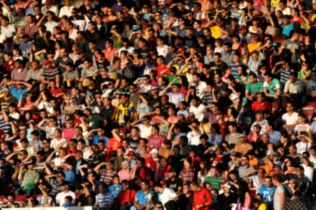 Blurred crowd of people at a football match in a stadium Stock Photo