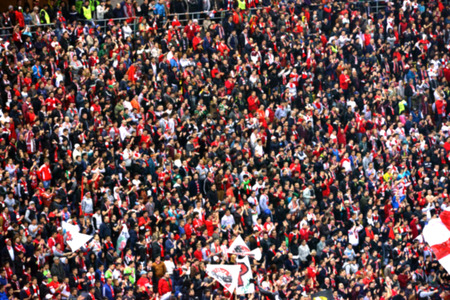 crowd of people: Blurred crowd of people in a stadium