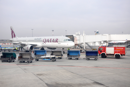 liszt: BUDAPEST- FEBRUAR 14: Airplane of Qatar Airways before taking his flight to Doha, at Liszt Ferenc Nation Airport. On february 14, 2013, in Budapest, Hungary