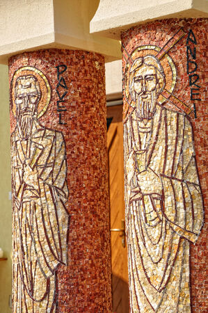 CLUJ - SEPTEMBER 14: Saint Paul and Saint Andrew, made from mosaic on the columns of the newly built Greek Catholic Church. On September 14, 2011 in Cluj-Napoca, Romania Editorial