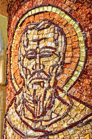 CLUJ - SEPTEMBER 14: Saint John apostle, made from mosaic on the column of the newly built Greek Catholic Church. On September 14, 2011 in Cluj-Napoca, Romania