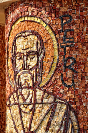 apostle: CLUJ - SEPTEMBER 14: Saint Peter apostle, made from mosaic on the column of the newly built Greek Catholic Church. On September 14, 2011 in Cluj-Napoca, Romania Editorial