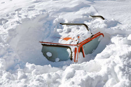 a blizzard: Snow covered car in the winter blizzard Stock Photo